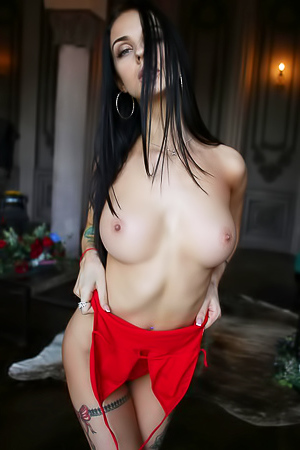 Glam brunette stripping off red dress